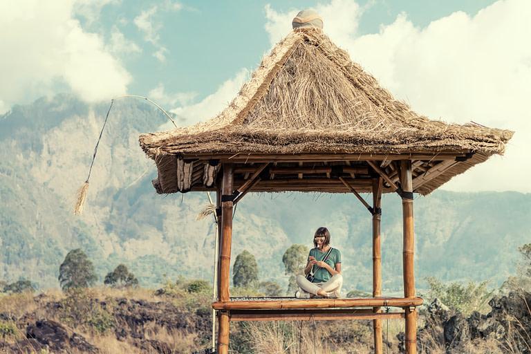 Woman sitting in a tall gazebo