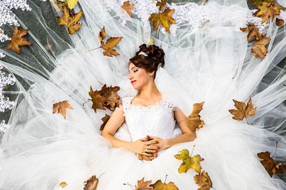 bride lying in backyard