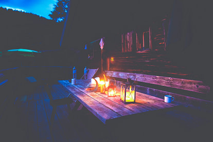 picnic table with lantern lighting