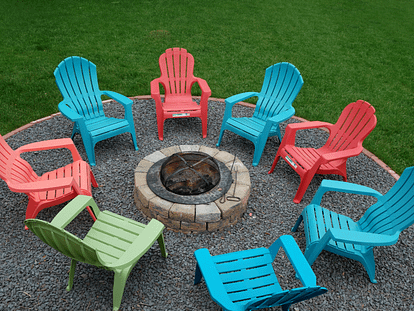 firepit surrounded by chairs