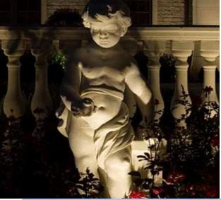 Statue lit by spotlight