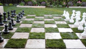 Giant chess set in backyard