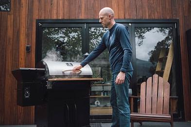 man near outdoor oven