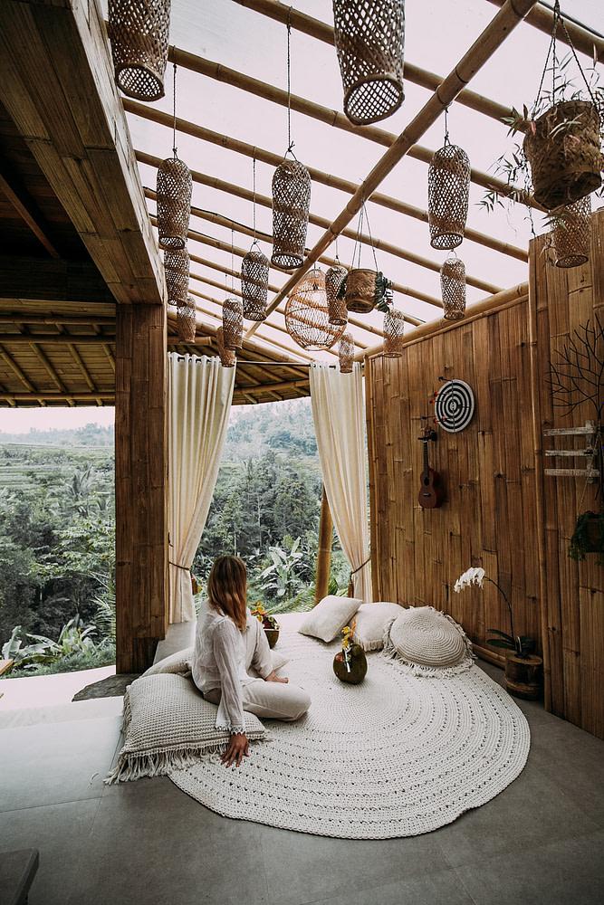 Woman meditating in a gazebo