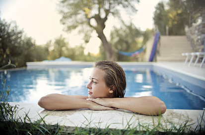 woman in backyard swimming pool